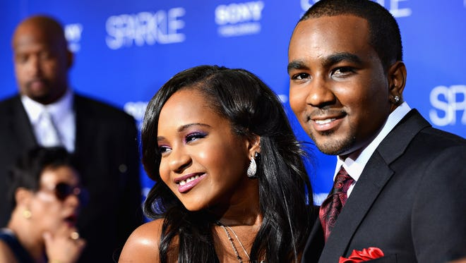 "Bobbi Kristina Brown, left, and Nick Gordon arrive at Tri-Star Pictures' ""Sparkle"" premiere at Grauman's Chinese Theatre on Aug. 16, 2012 in Hollywood. New court documents released Friday, Oct. 9, 2015, say Gordon injected Brown with a toxic cocktail after putting her in a bathtub."