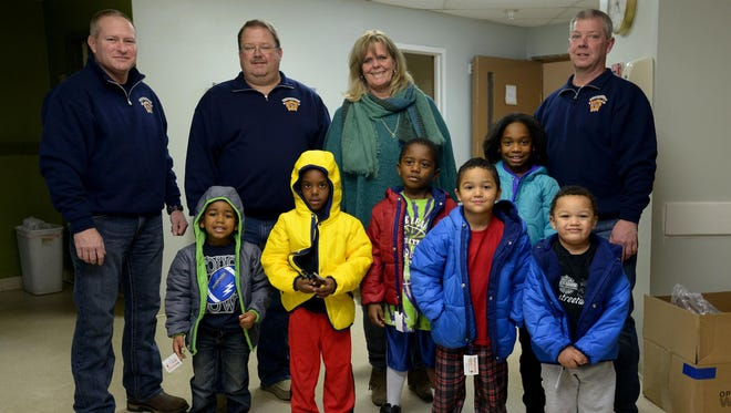 Members of the Jackson Fire Department donated coats to children of The Dream Center on Thursday.