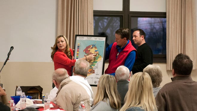 Keep Catawba Island Safe co-chair Megan Meisler points to the parcel of and where a proposed Dollar General store would go on a map during the group's fundraiser at the Catawba Island Township Community Hall on Monday evening.