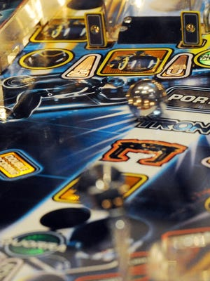 A ball rolls across the board on a Tron pinball game during the Fountain Square Pinball Classic at LaMargarita restaurant on Feb. 17, 2013.