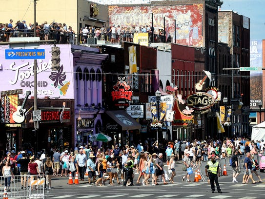 A crowd fills Lower Broadway during the third day of