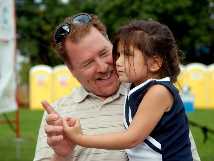 Curtis Moudry dances with his daughter, Catia, 4, at the Bluegrass & Bourbon Festival at the Water Tower.  Aug. 31, 2014