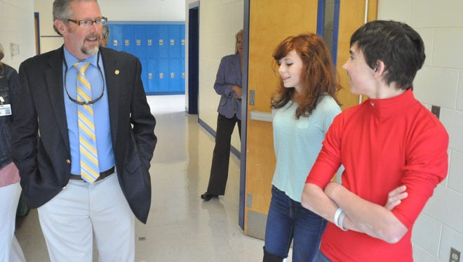 Madison County Public Schools superintendent Todd Holden visits with students at Madison Middle School.