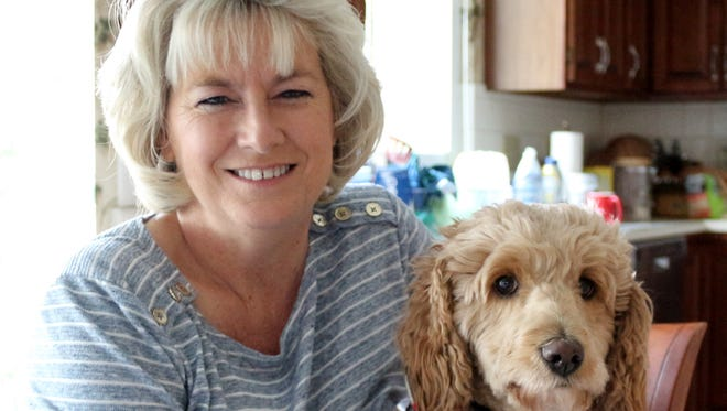 Ann Mills with her dog Macy. It's been about seven months since her kidney transplant surgery and she's making a good recovery, thanks to the generosity of a stranger.