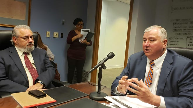 House Speaker Larry Householder, R-Glenford, talks to reporters in 2019 about the new Ohio Clean Air Program while Rep. Jamie Callender, R-Concord, a prime sponsor of the bill, listens.