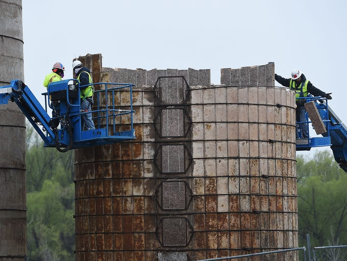 Workers continue to dismantle the 100-year-old silos