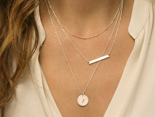 Layering necklaces, including an initial necklace,