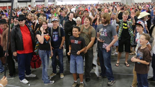 In another section of the Salt Palace, thousands of people wait patiently for Salt Lake Comic Con 2015 to begin on Sept. 24, 2015.