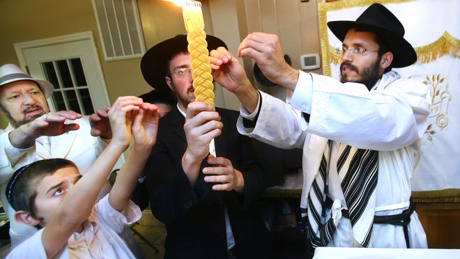 Rabbi Schneur Oirechman during a previous Yom Kippur in at Chabad Lubavitch.