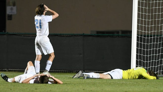 Maclay players react to their 2OT loss to Palmer Trinity in Thursday's Class 1A boys state soccer final.