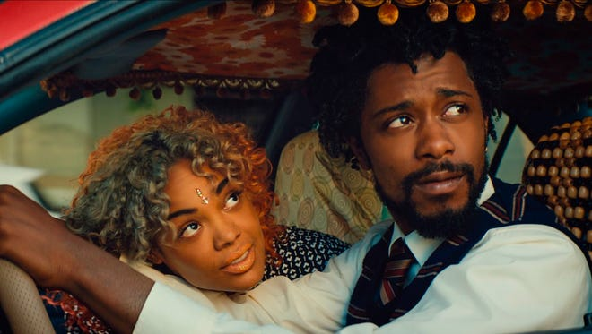 """Tessa Thompson, left, and Lakeith Stanfield in a scene from """"Sorry to Bother You."""" It opens Friday."""