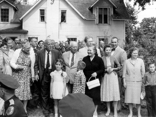 Left to right in this 1959 photo are Elizabeth Garst (in the print dress), Roswell Garst, Nikita Khrushchev, Nina Khrushchev and daughters Julia and Randa Khrushchev. Young Elizabeth Garst, then 8 years old, stands front left.