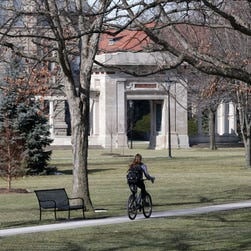 A student rides a bicycle on the campus of Oberlin College Oberlin, Ohio.