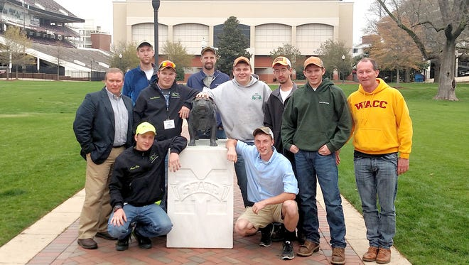 The Penn College contingent gathers during the recent National Collegiate Landscape Competition held at Mississippi State University. Aaryn C. Hoy, of Norristown, left, and Kenneth E. Zeager Jr., of Bainbridge, are pictured in the front row. Pictured in the middle row, from left, are: Carl J. Bower Jr., instructor; students Justin M. Rinehimer, of Mountain Top; Zachary M. Meling, of Hawley; Joshua T. Posey, of York Haven; and Ryan Rousseau, of Pipersville; and Ronald A. Burger, alumni mentor. Elliot C. Redding, of Gettysburg, and Kyle M. Richardson, of Hopewell, are pictured in the back row.