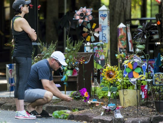 An unidentified man and woman leave flowers in front of the Emporium at Mt. Gretna hours after the owner, Stacey Pennington, was shot to death by her ex-boyfriend, Patrick Derr, who then turned the gun on himself. Derr was on life support, according to police. Cornwall Borough Police, Lebanon County Detectives and the Lebanon County District Attorney's office investigated a murder-attempted suicide outside of the Jigger Shop in Mt. Gretna Borough on Monday, September 7, 2015. Police were called to the area just after 11:30 a.m. and found Stacy Pennington, owner of The Emporium at Mt. Gretna, dead and the shooter, Patrick Derr, still alive. Derr was transported to Hershey Medical Center via Life Lion helicopter, according to police. Jeremy Long -- Lebanon Daily News