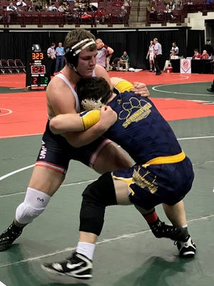 Ashland's Josh Bever hits a double underhook en route to pinning projected state champ Joe Cochran of Springfield in Thursday's first round of the state wrestling tournament.