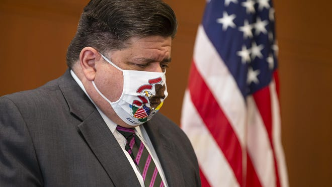Illinois Gov. JB Pritzker lowers his head during a news conference on September 21, 2020, in Springfield.