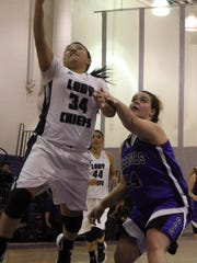 Julie Paz attempts a layup while being defended by Gateway's Shaye Nelson.