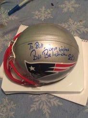 The Patriots sent Bill Duggan a small helmet autographed