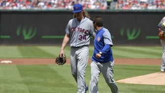 Injured Mets starting pitcher Noah Syndergaard leaves during the second inning Sunday against the Washington Nationals.