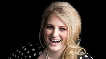"""American singer-songwriter Meghan Trainor, known for the pop single """"All About That Bass,"""" poses for a portrait, on Thursday in New York."""