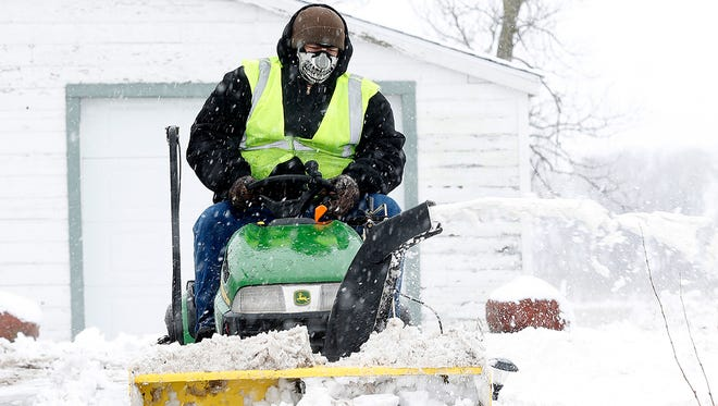 Justin Manke snow blows his driveway on Highway 26 between Rosendale and Waupun during a snowstorm in January of 2017.