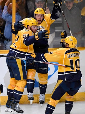 Nashville Predators center Colton Sissons (10) celebrates his third goal with defenseman Matt Irwin (52) and center Calle Jarnkrok (19) during the third period of game 6 of the Western Conference finals at Bridgestone Arena Monday, May 22, 2017 in Nashville, Tenn.