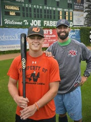 St. Cloud Cathedral graduate Tom Imholte, left, is playing catcher for the Mankato MoonDogs this year while his brother, Phil, is a former player and current assistant coach for the St. Cloud Rox.