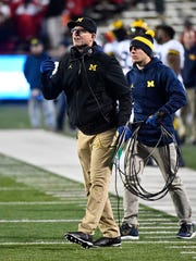Michigan coach Jim Harbaugh yells instructions against Maryland on Nov. 11.