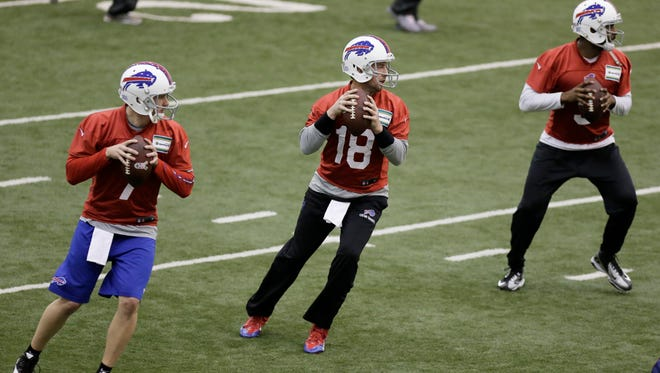 Bills quarterbacks Jeff Tuel, left, Kyle Orton, center, and EJ Manuel practice Saturday at the Lions' indoor facility.