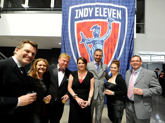 Indy Eleven goal keeper Kristian Nicht, center, stands with supporters at the Dallara IndyCar Factory for the Inaugural Kickoff Ball, Saturday, April 5. Proceeds from the ball will benefit the Indiana Soccer Foundation, working with Indy Eleven to build a futsal field at an Indianapolis park.