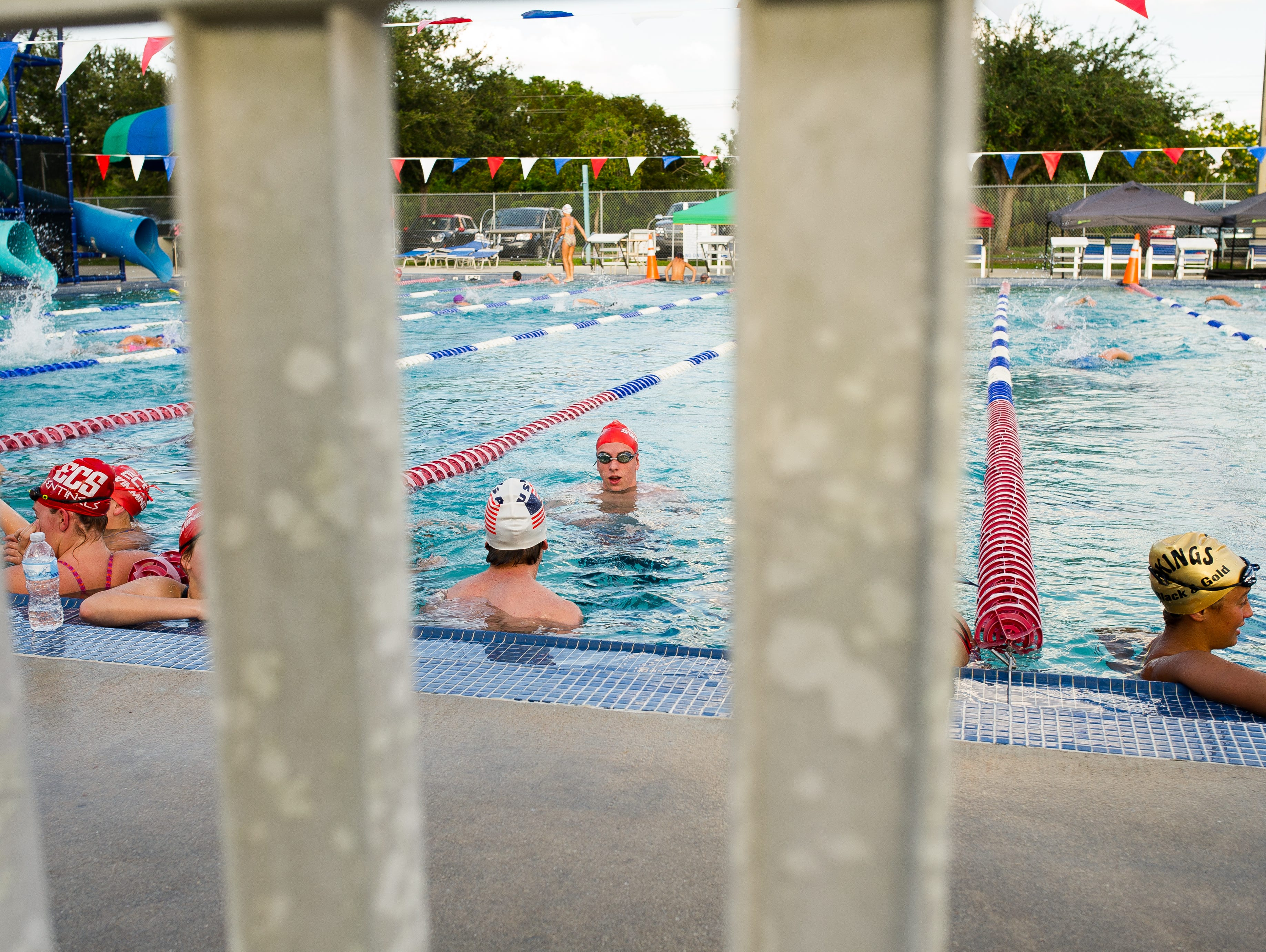 Students swim on Thursday, October 15, 2015 during Evangelical Christian School's swim practice held at the Fort Myers Aquatic Center in Fort Myers Fla. The team is undefeated heading into districts next week.