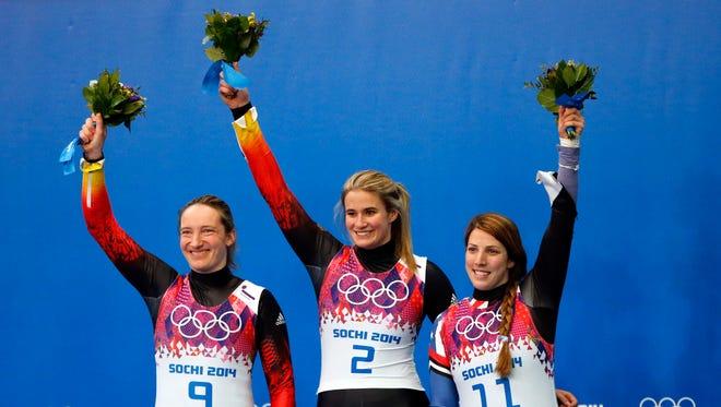 Luge gold medalist Natalie Geisenberger, center, of Germany, silver medalist Tatjana Huefner, left, of Germany, and bronze medalist Erin Hamlin (of the USA.