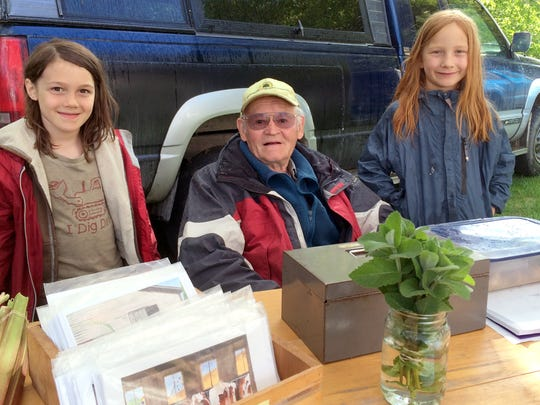"""Founding Richmond Farmers Market member Ted Sargeant, 86, of """"Still At It"""" Farm in Huntington shares a stand with Emmitt, 9, (on right) and Reuben Hayes, 7, whose family's Village Farm is neighbors with Sargeant."""