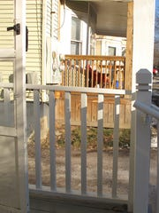 A porch at 92-94 Buell Street in Burlington (unpainted),