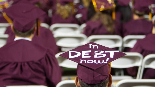 ASU graduate students with debt also have about $10,000 less debt than the national average. (Photo by David Wallace/ The Arizona Republic)