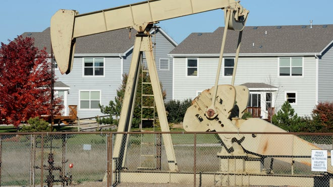 A pump jack operates   in the Hearthfire subdivision north of Fort Collins in this Oct. 23, 2013,   photo.