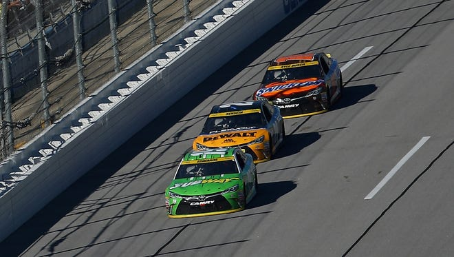 (From front to back) Joe Gibbs Racing teammates Carl Edwards, Matt Kenseth and Kyle Busch purposely trailed the field for most of the day at Talladega Superspeedway.