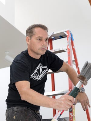 """Shepard Fairey has been busy this week setting up  his exhibit, """"Shepard Fairey: Salad Days, 1989-1999,"""" at the Cranbrook Art Museum in Bloomfield Hills."""