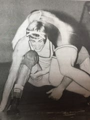 Jason Walls prepared to lift Paducah Tilghman's Jason Cox into the air during a match in the 171-pound class in January 1996. The Braves posted a 59-17 victory that night.