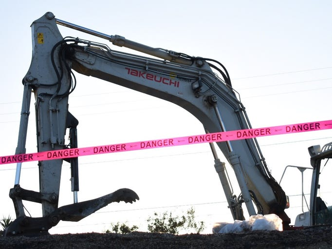 Heavy equipment is used to clear the rubble that was