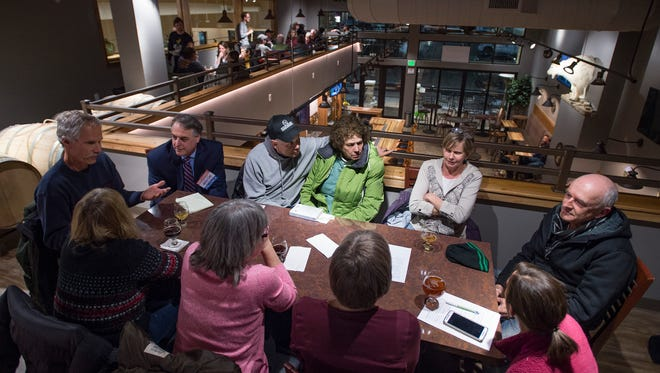 People discuss issues surrounding retirement and Fort Collins as a whole during Brews & News at Gilded Goat Brewing Company Thursday, February 23, 2017.