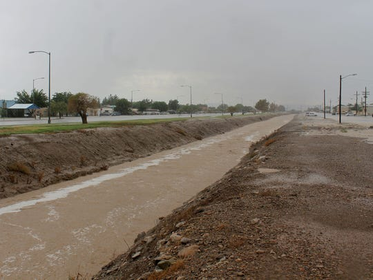 Flood waters rapidly filled the canal along Indian Wells Road and Canal Street.