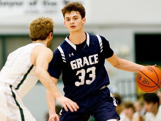 Grace Christian's CJ Gettelfinger (33) looks for a way around the defense during a game between Webb and grace Christian at Webb High School in Knoxville, Tennessee on Friday, January 19, 2018.