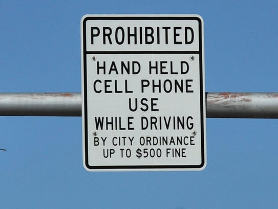 laws against cell phone use while driving essay