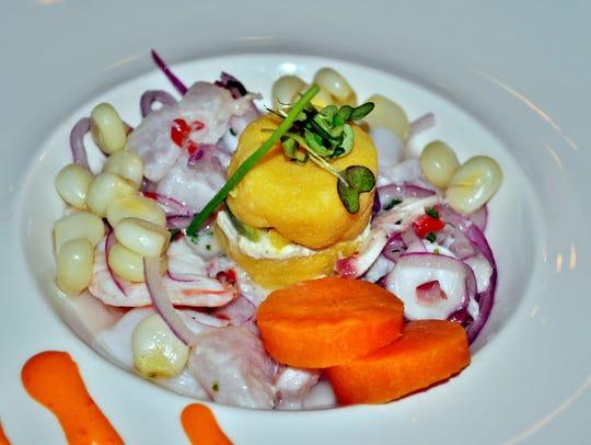 Ceviche, a staple of Peruvian cuisine, takes center