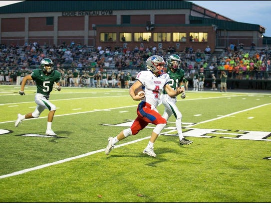 Junior quarterback Clark Gray gets the Patriots off