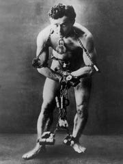 Legendary escape artist Harry Houdini is shown in chains