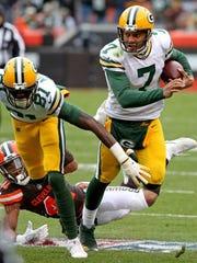 Green Bay Packers quarterback Brett Hundley (7) scrambles