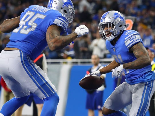 Lions running back Ameer Abdullah, right, celebrates his touchdown with Eric Ebron in the fourth quarter of the season finale against the Packers at Ford Field. Abdullah finished the season with 552 yards rushing on 165 carries (3.3 average) and four TDs.